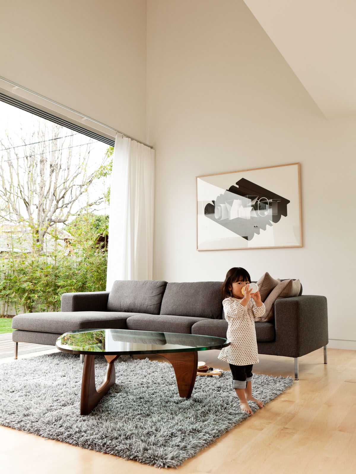 Living room with Ikea Stockholm Wool Rug and Noguchi table