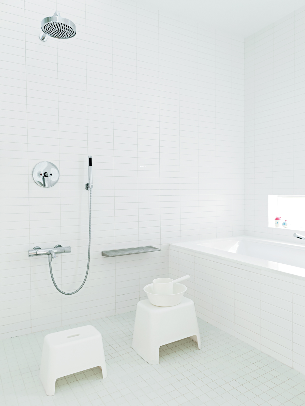 All-white master bathroom with Japanese-inspired communal shower