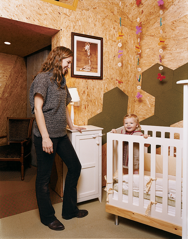 Young parents Ainsley Ryan and Chris Showalter created a freestanding OSB (oriented strand board) structure inside their Brooklyn, New York, apartment to house their daughter Tatum's room, as well as their own connecting master bedroom. The crib is by Oeu