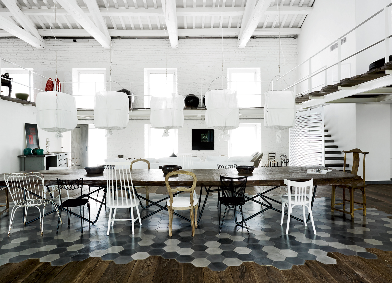 Paloa Navone designed living-dining room with chairs.