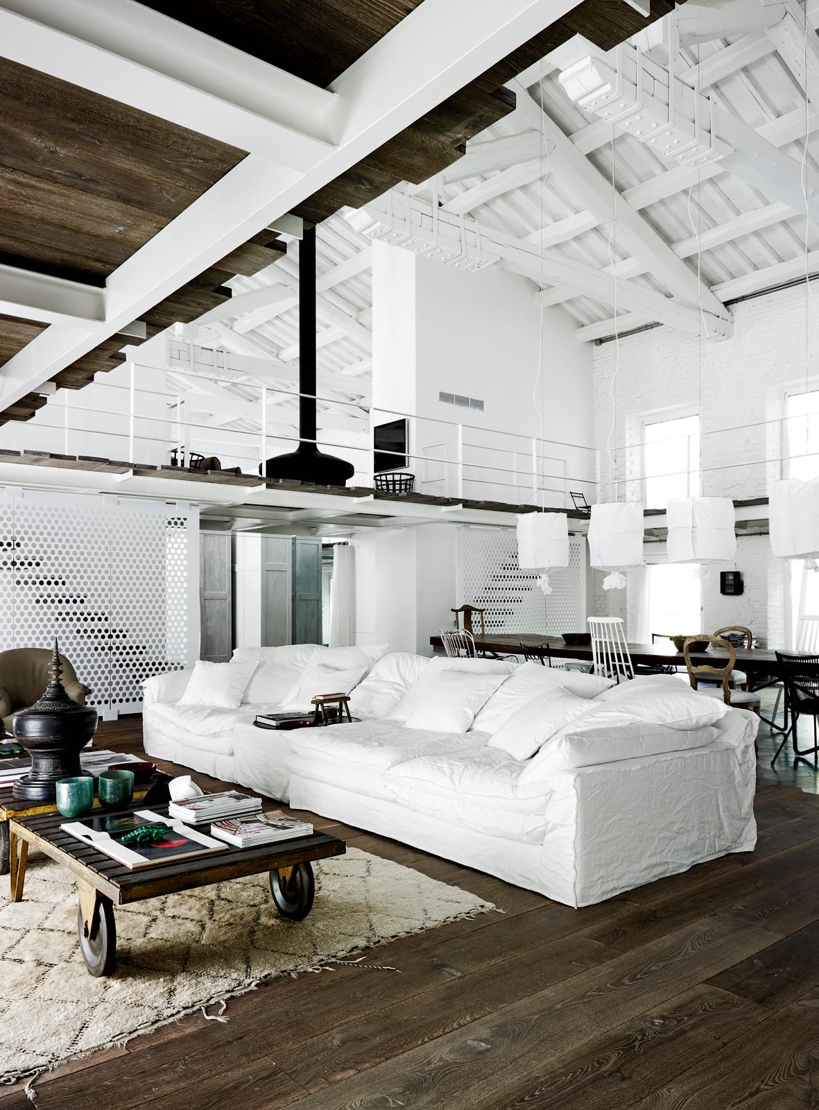 White sofa in loft apartment.