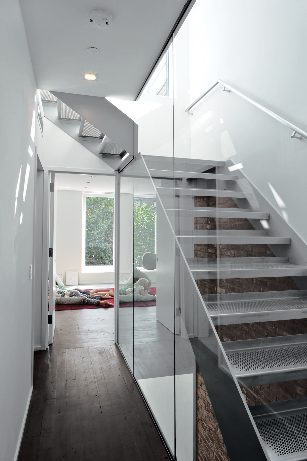Custom stainless steel staircase with perforated steel treads