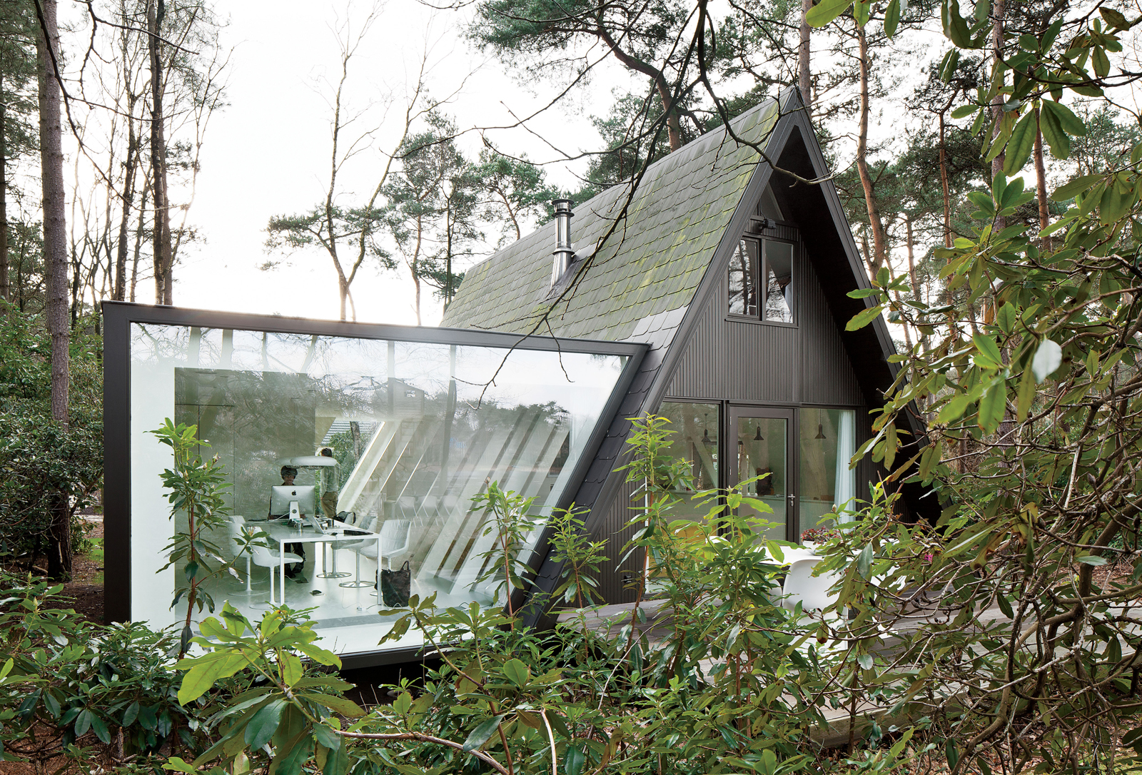 Modern glass extension in Belgium.