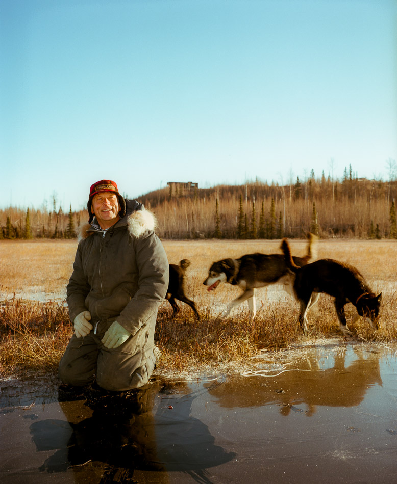 Alaska homeowner with dogs by Kamil Bialous