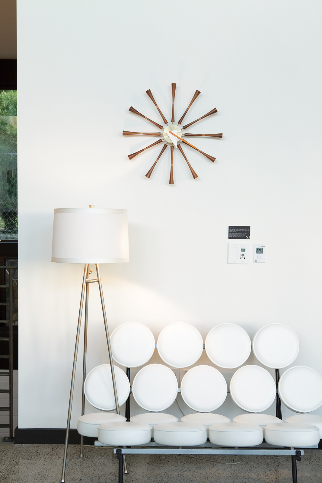 Marshmallow sofa, clock, white lamp