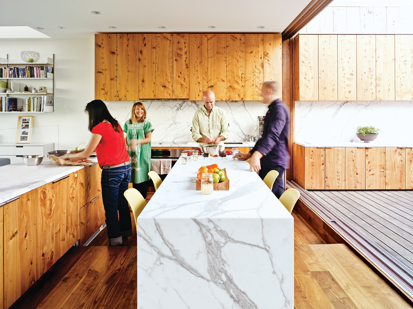 Modern kitchen with white Carrara marble countertops and cypress cabinets