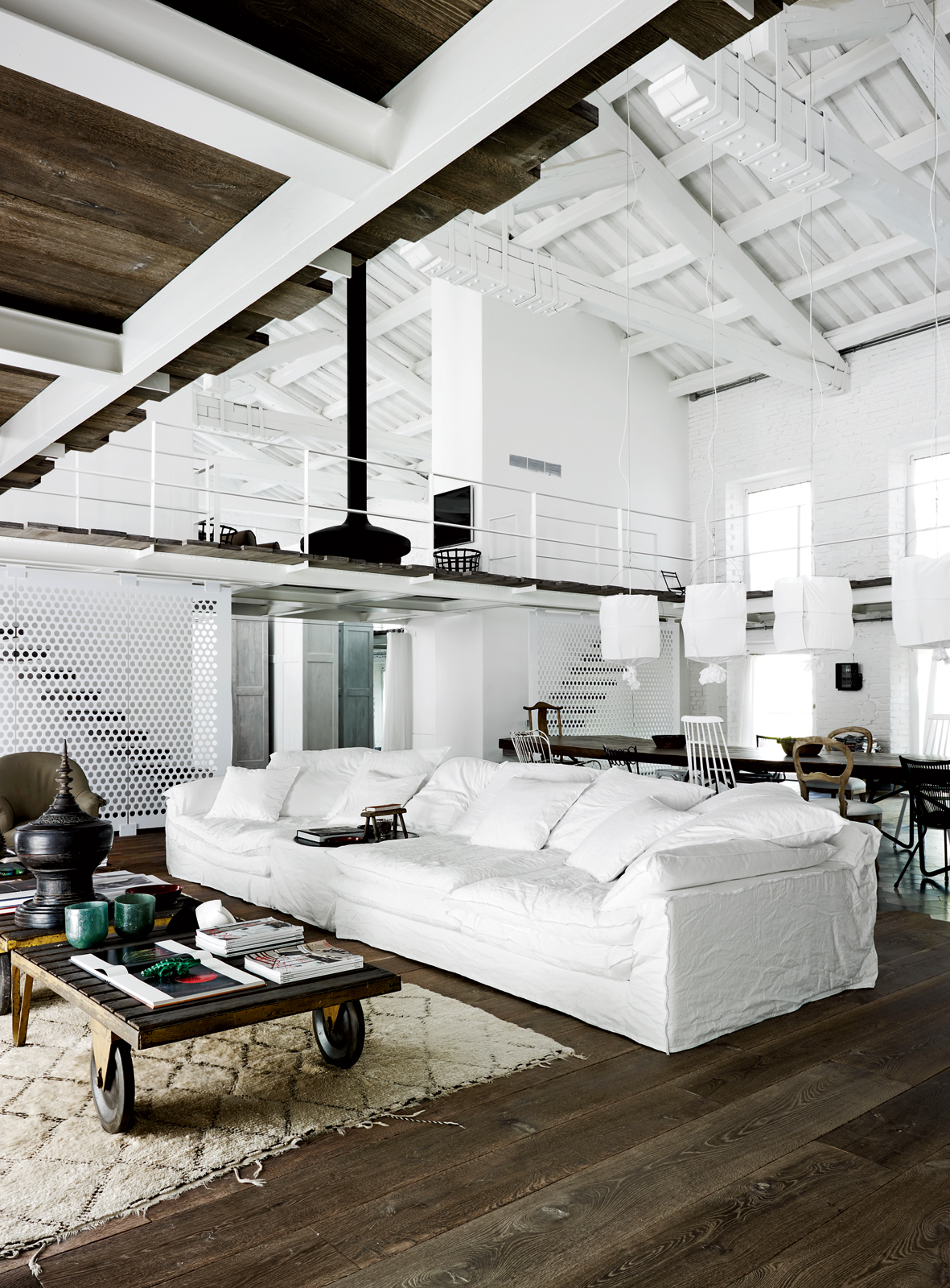 white couch white loft dark wood floors