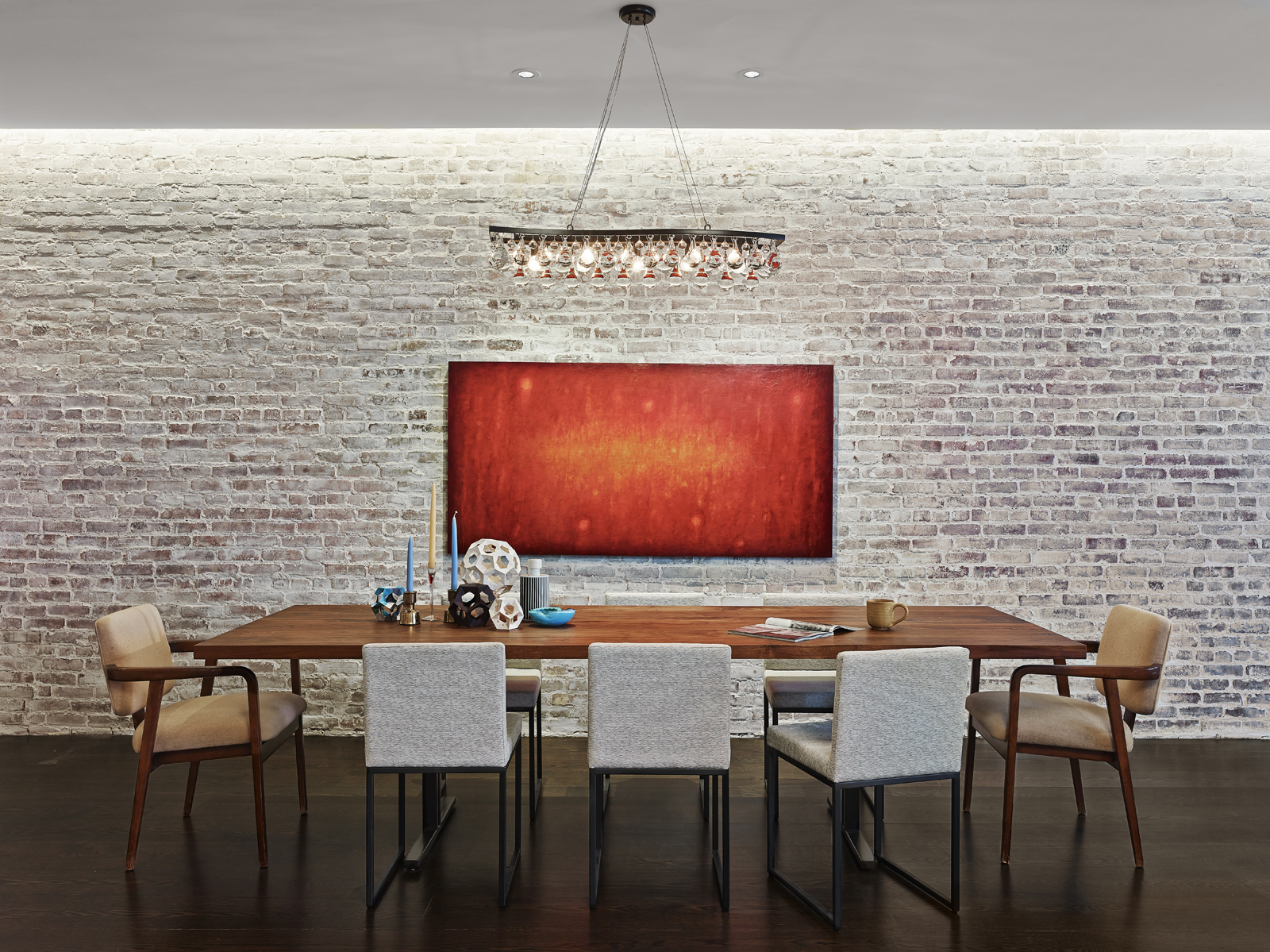 modern dining room with brick wall