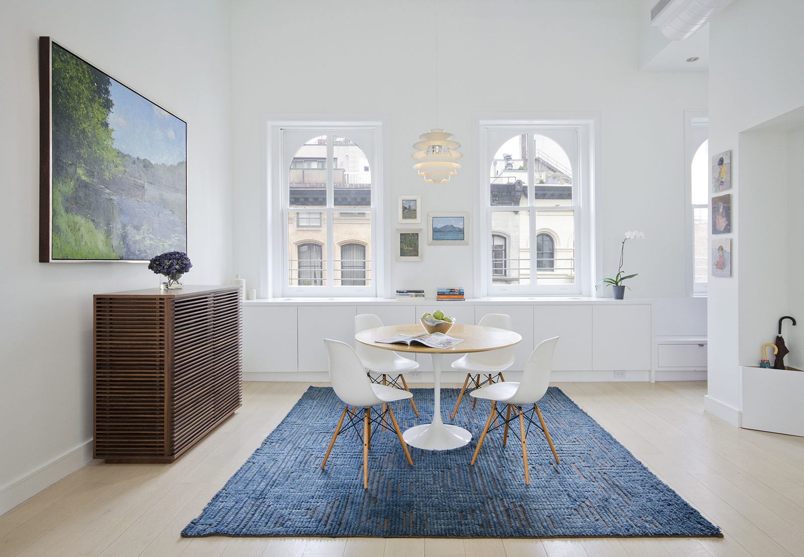 renovated loft with Eames shell chairs and tulip table