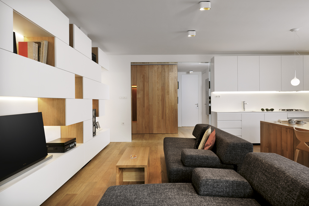 modern living room with gray sofas and white built-in shelving