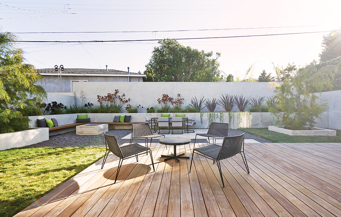 California house backyard with wooden deck and lounge seating