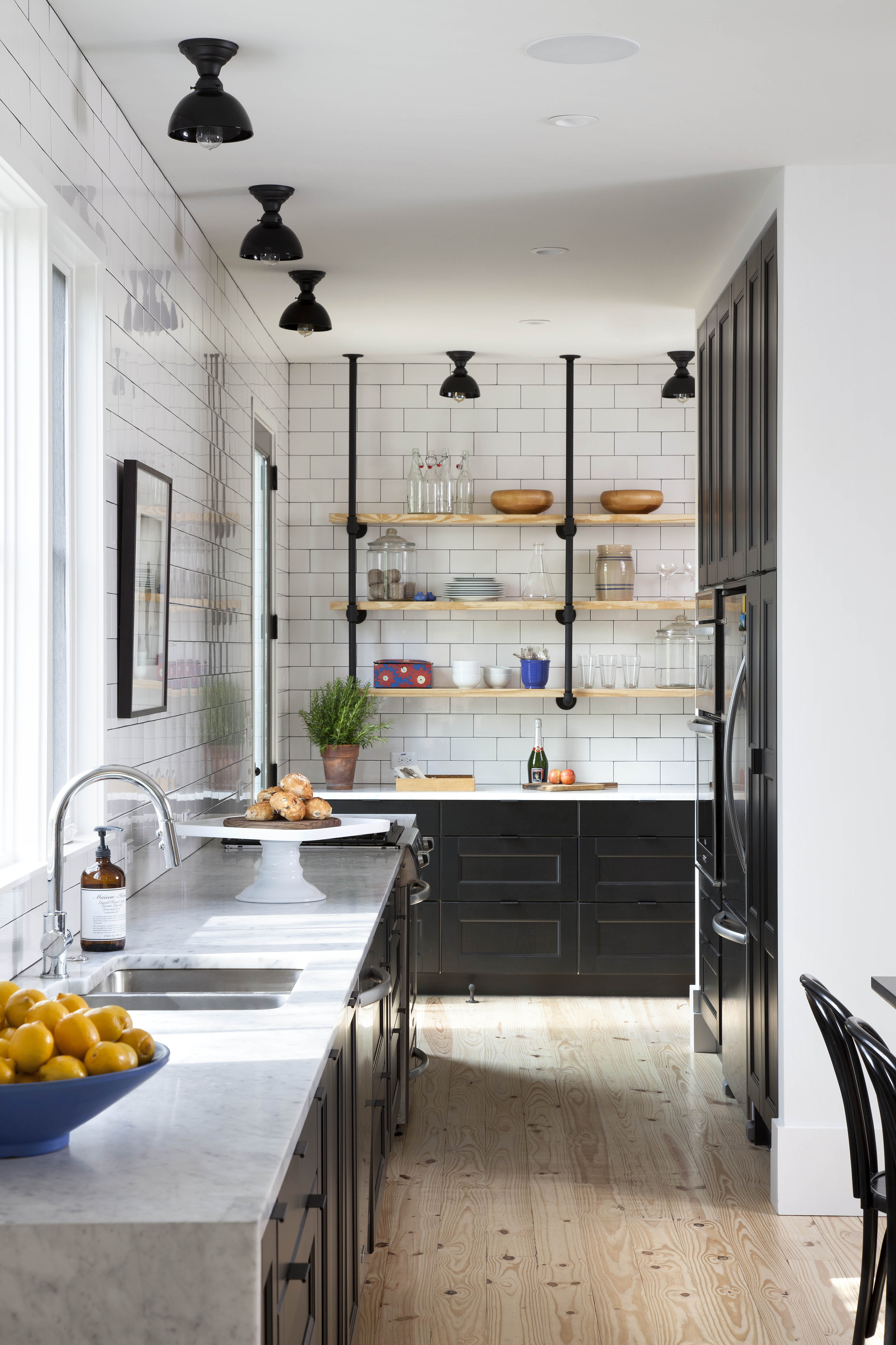 Modern kitchen with white subway tiles and black cabinets