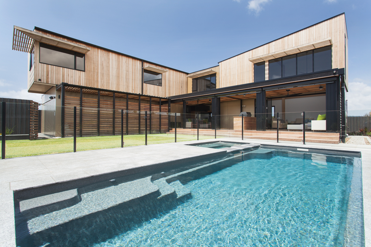 Byron Bay wood-clad house with pool.