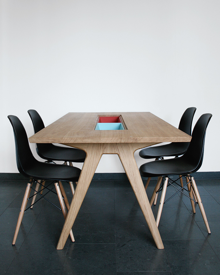 Wooden dining table with storage cases and Eames side chairs