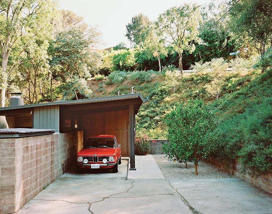 Crestwood Renovation carport leads to entrance.
