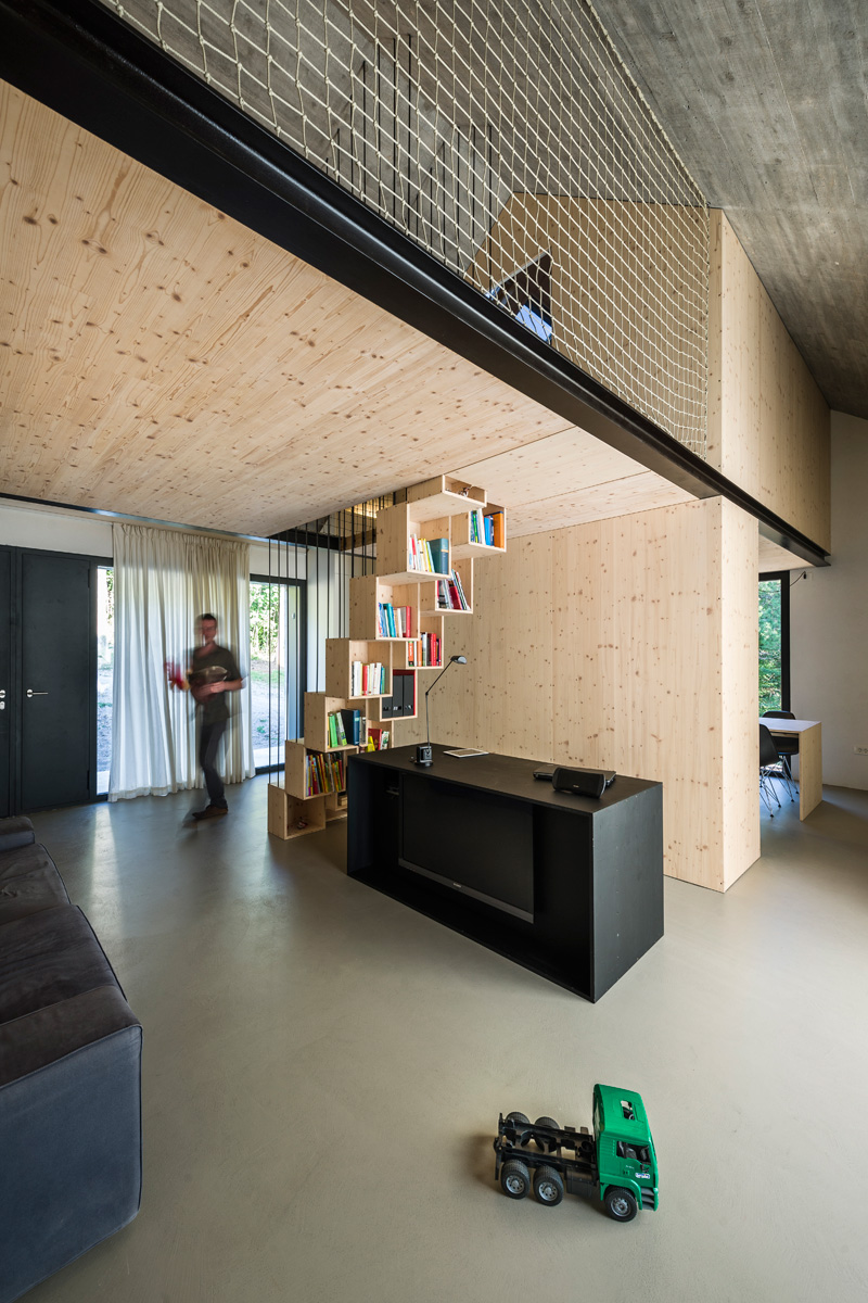 Stone house in Karst with bookshelf under the stairs
