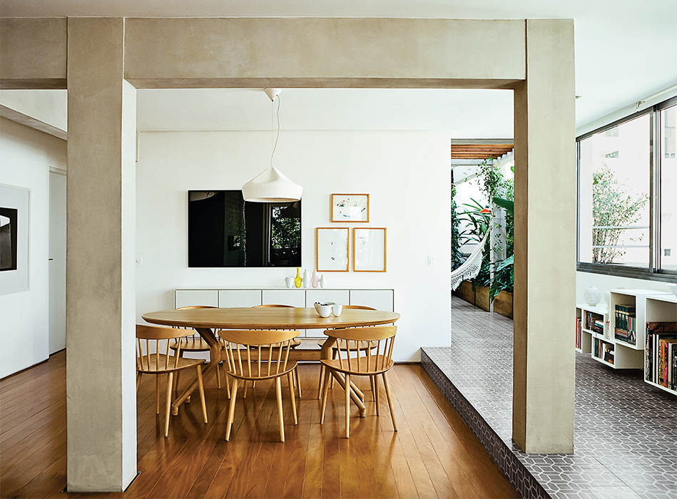 São Paulo apartment dining room with local wood floors and HAY chairs
