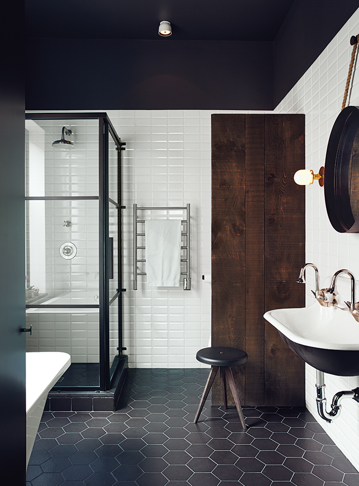 Renovated Montreal bathroom with black and white Ceragres tiles