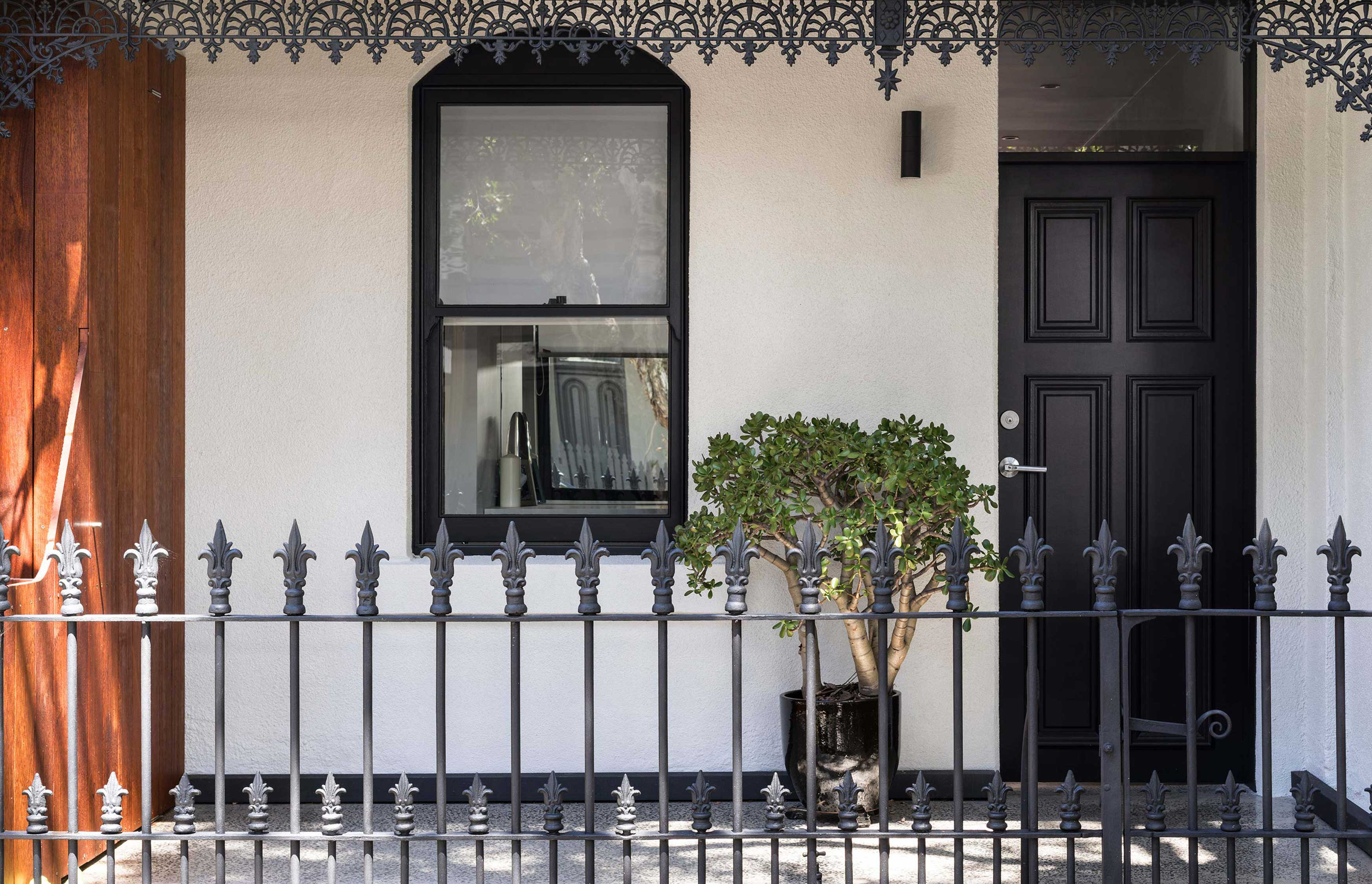 Stucco exterior of a renovated terrace house in Sydney