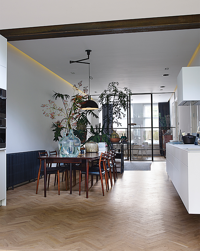 Amsterdam loft with open dining room and succulents between spaces
