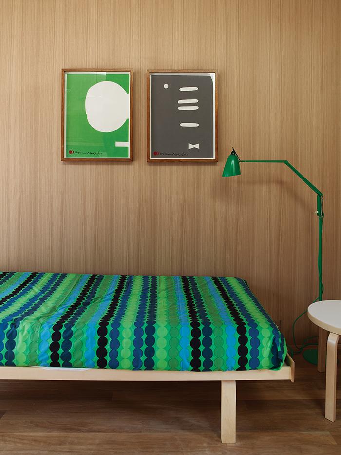 Australian studio with green Marimekko bedding and floor lamp