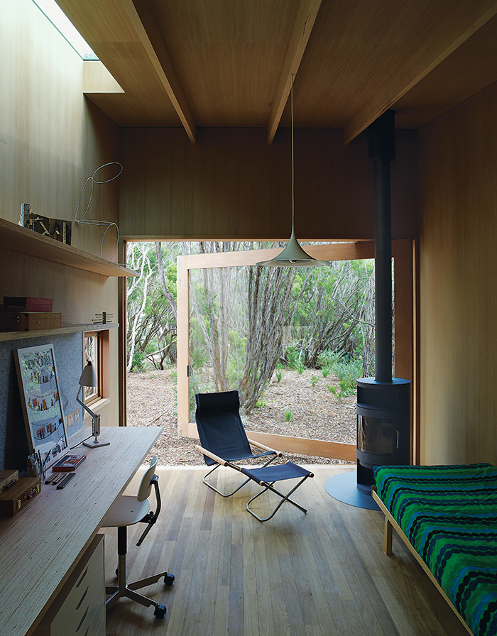 Australian studio with open glass door and wood-burning stove