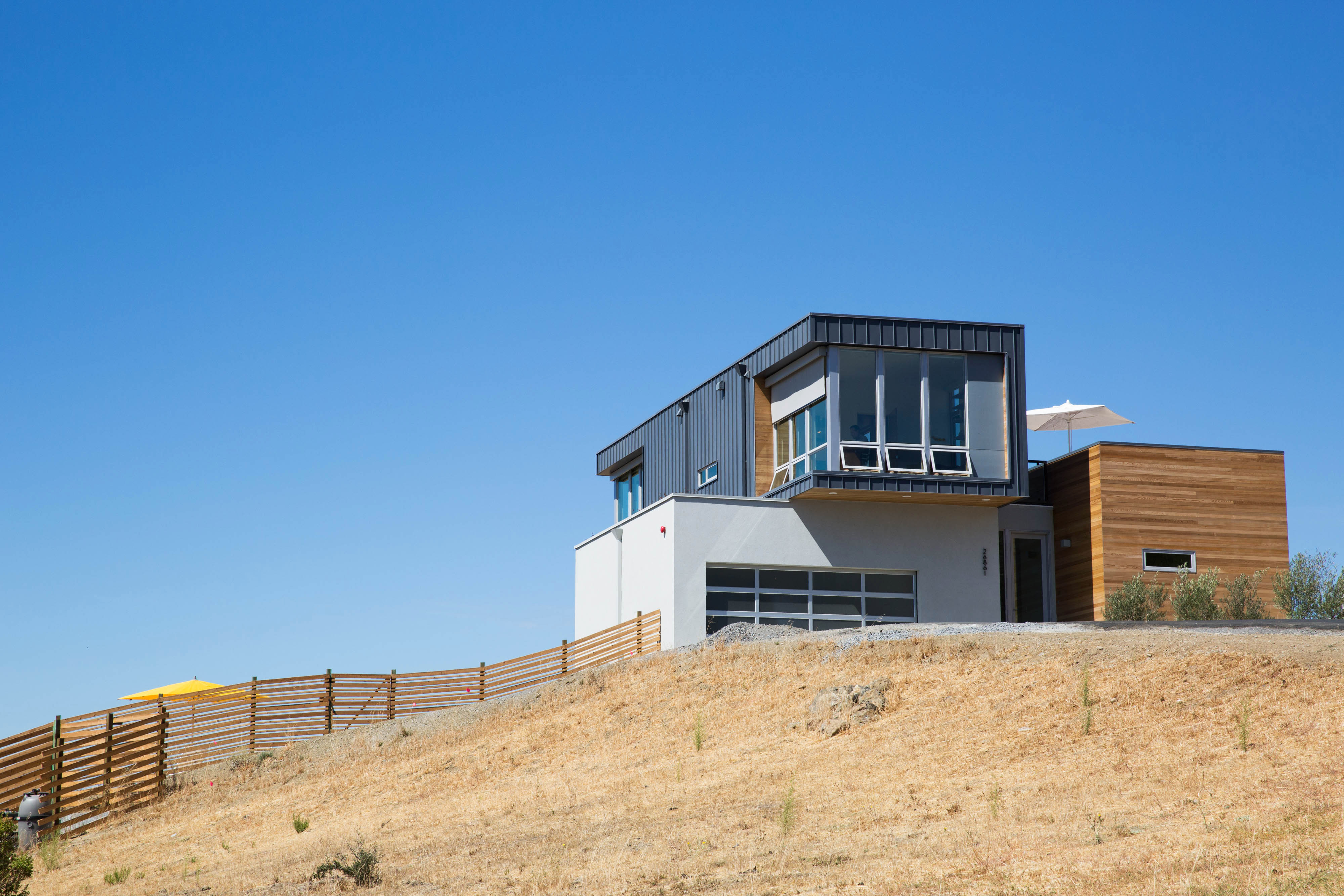 Cloverdale Prefab Home showing exterior from hill