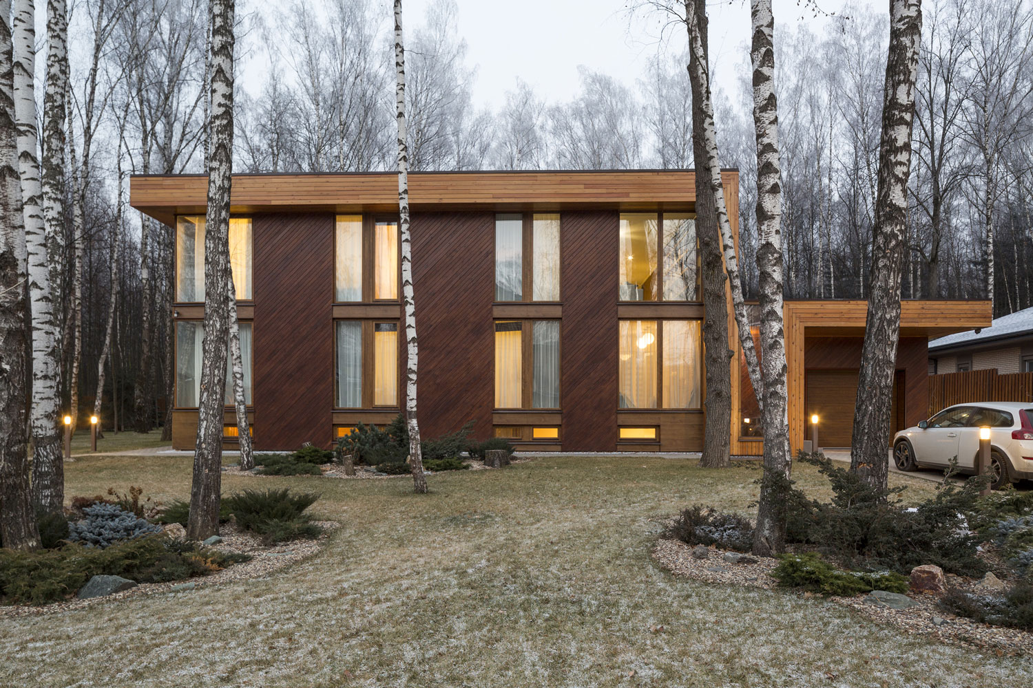 Russian house in a birch tree forest