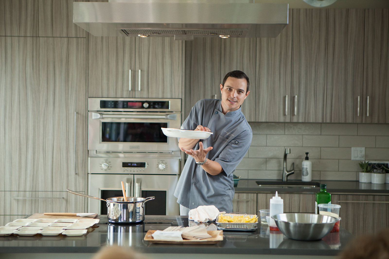 Chef Jon conducts a product demonstration at the Monogram Modern Home.