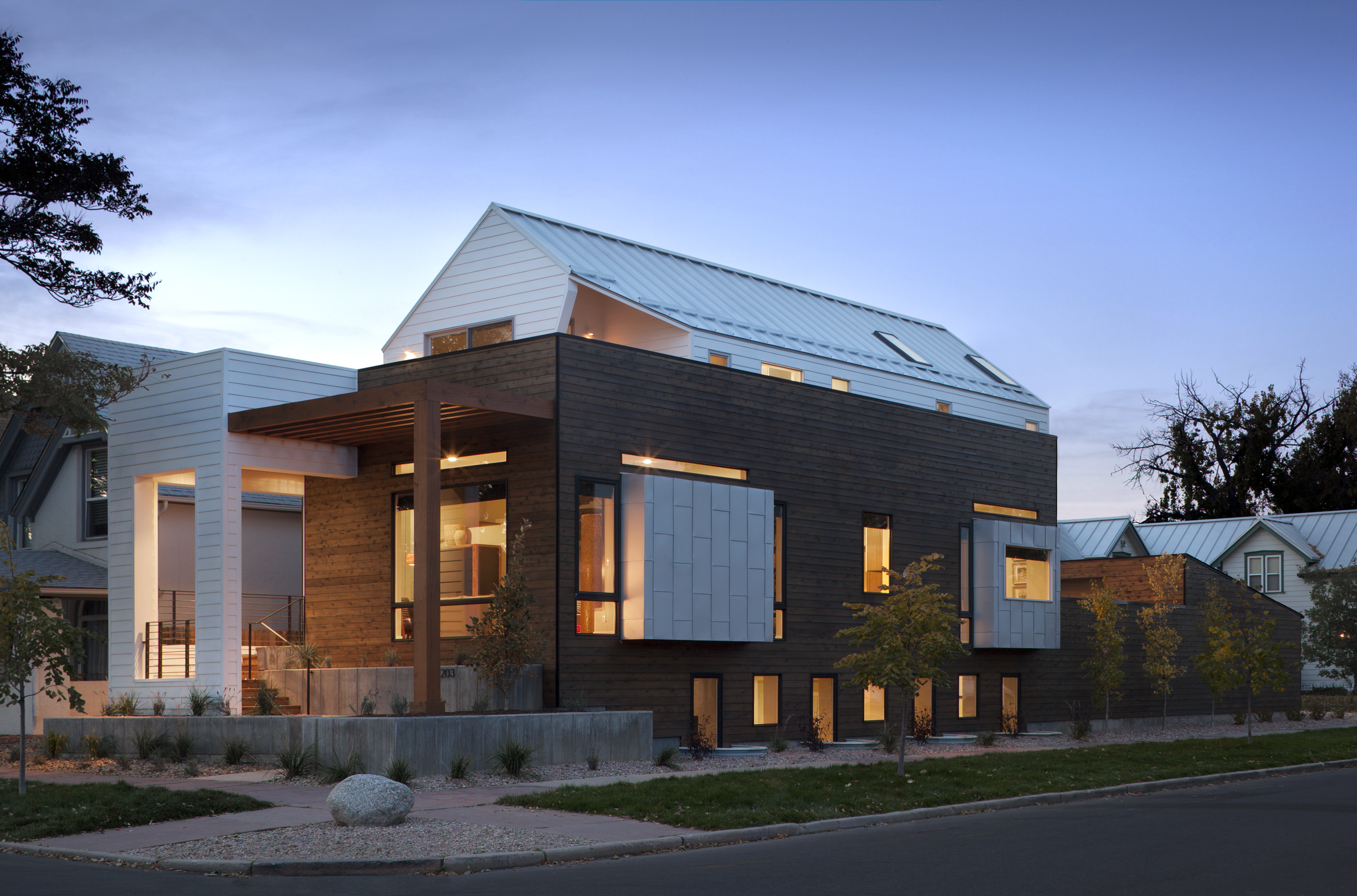 Denver home with setback top floor to create roof deck space.