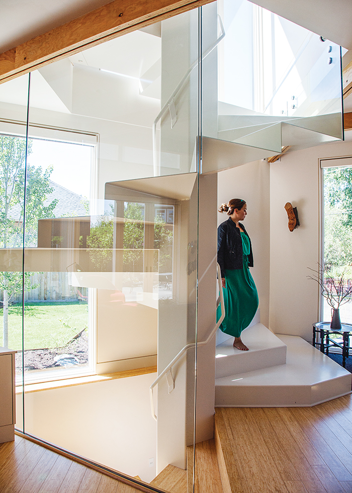 Modern prefab modular and triangular home by HOMB in Portland glass enclosed spiral staircase hexagon