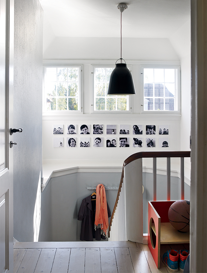 Copenhagen renovation stairwell with pendant lamp by Cecilie Manz.