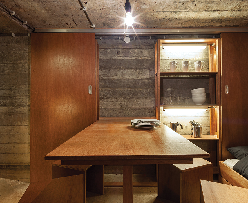 Custom meranti-finished plywood furniture in bunker retreat in the neatherlands