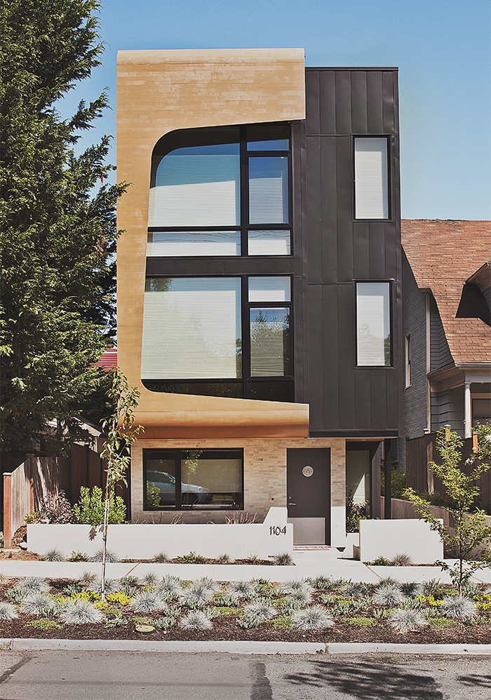 Modern multifamily home in Seattle with cedar and metal siding on the facade