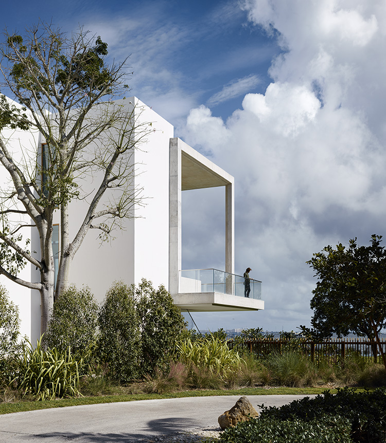 Casa Bahia by Alejandro Landes features a cantilevered balcony overlooking Biscayne Bay in Miami, Florida