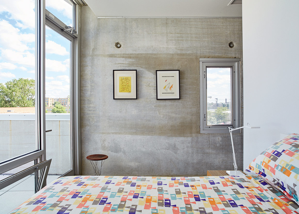 Mondern prefab Chicago live/work space by UrbanLab with knoll stool and flos floor lamp in the bedroom