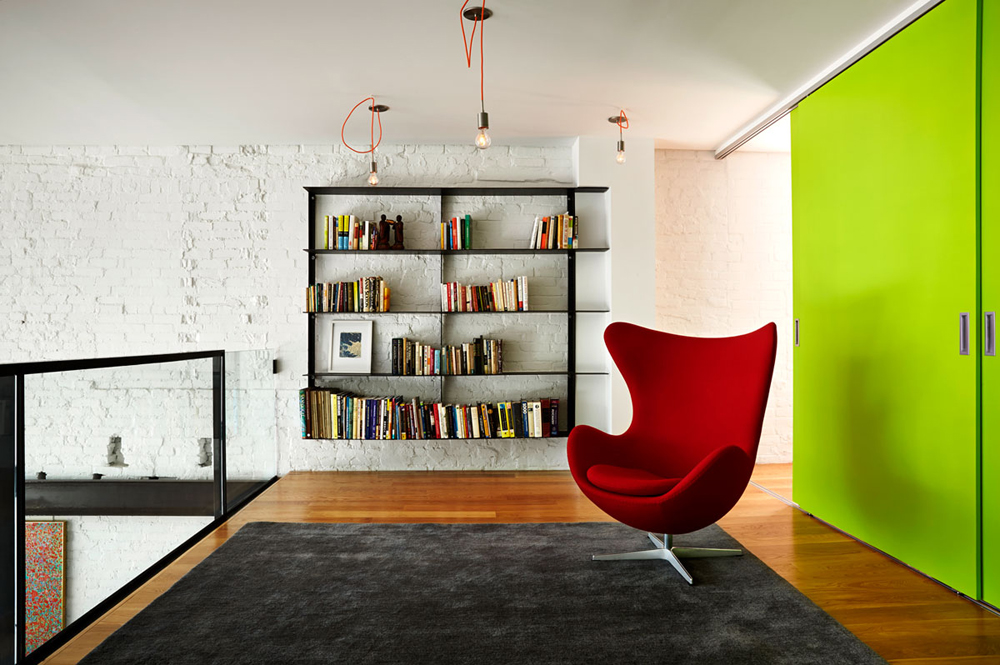 Renovated DC Row House loft space with Arne Jacobsen Egg Chair.