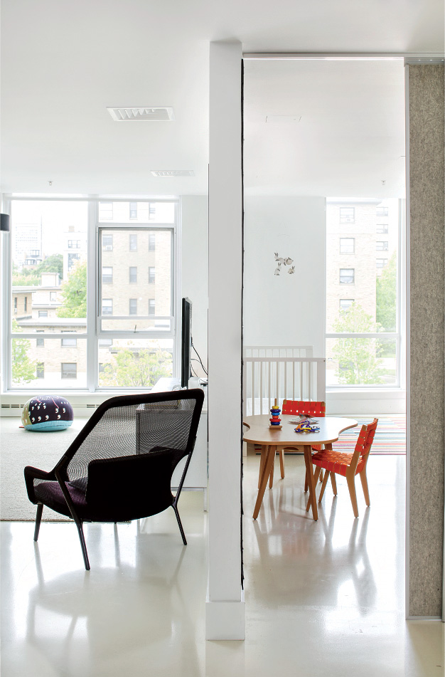 Boston renovation with acoustic separation through sliding doors.