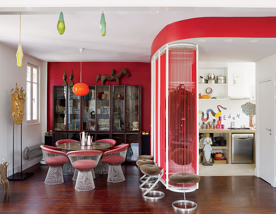 Colorful dining room and kitchen in Nicolas Roche's Paris apartment