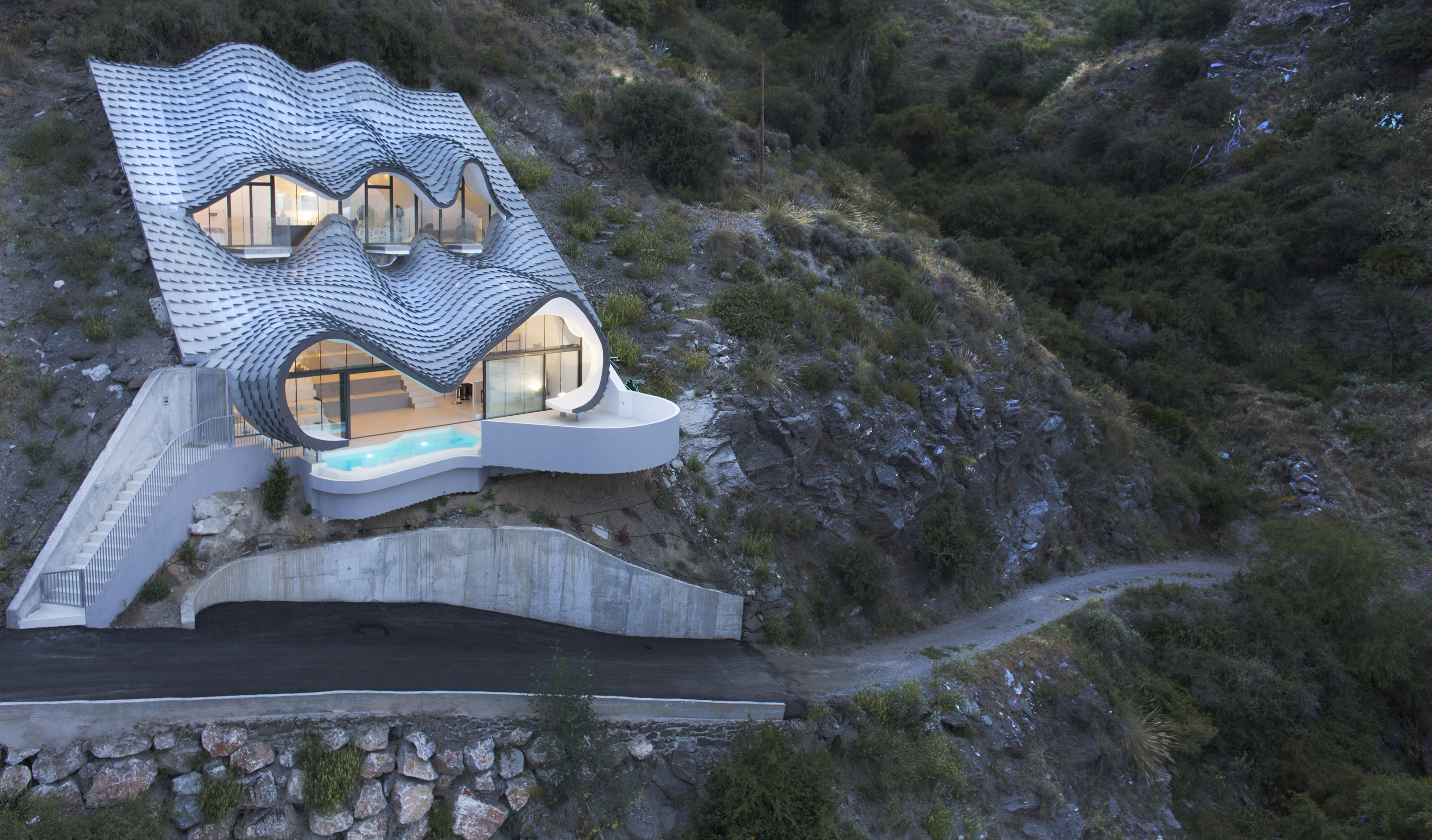 Spanish home embedded in hillside.