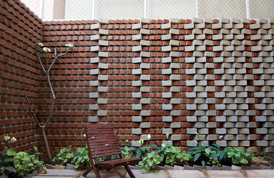 Bangalore, India house with green, earth bricks in their backyard garden