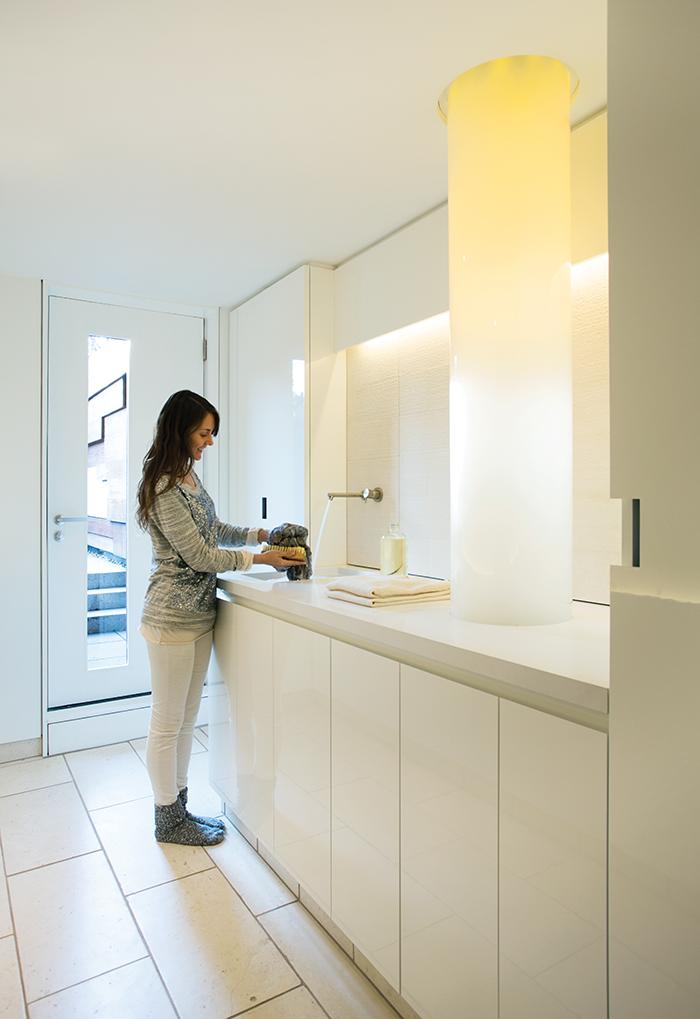 Modern laundry room with fiber-optic chute