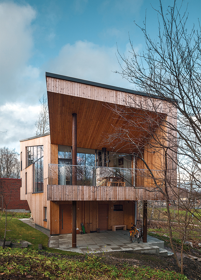 Modern home in Finland with sauna has larch wood exterior facade