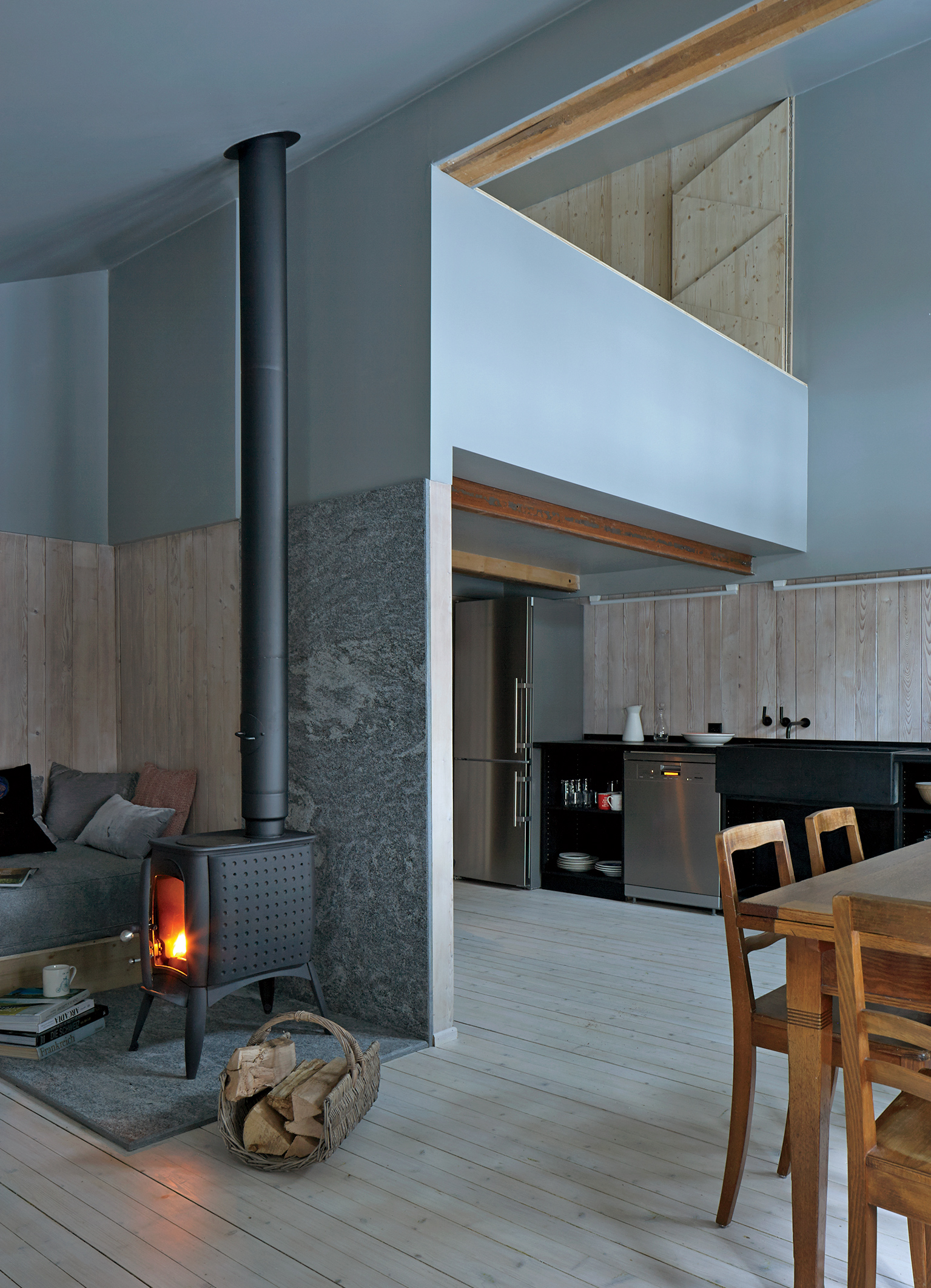 Swiss family getaway small space renovation with stove in main room