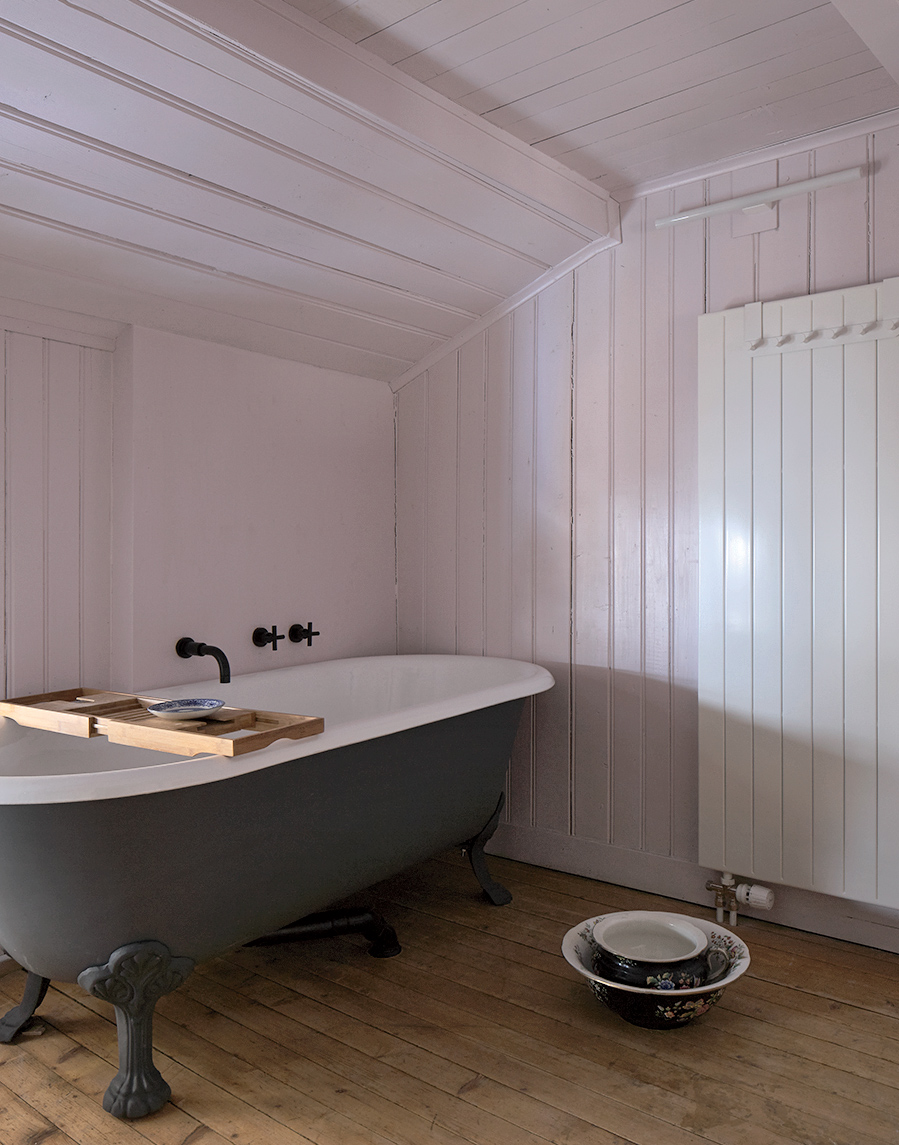 Swiss family getaway small space renovation with pink bathroom and enamelware tub