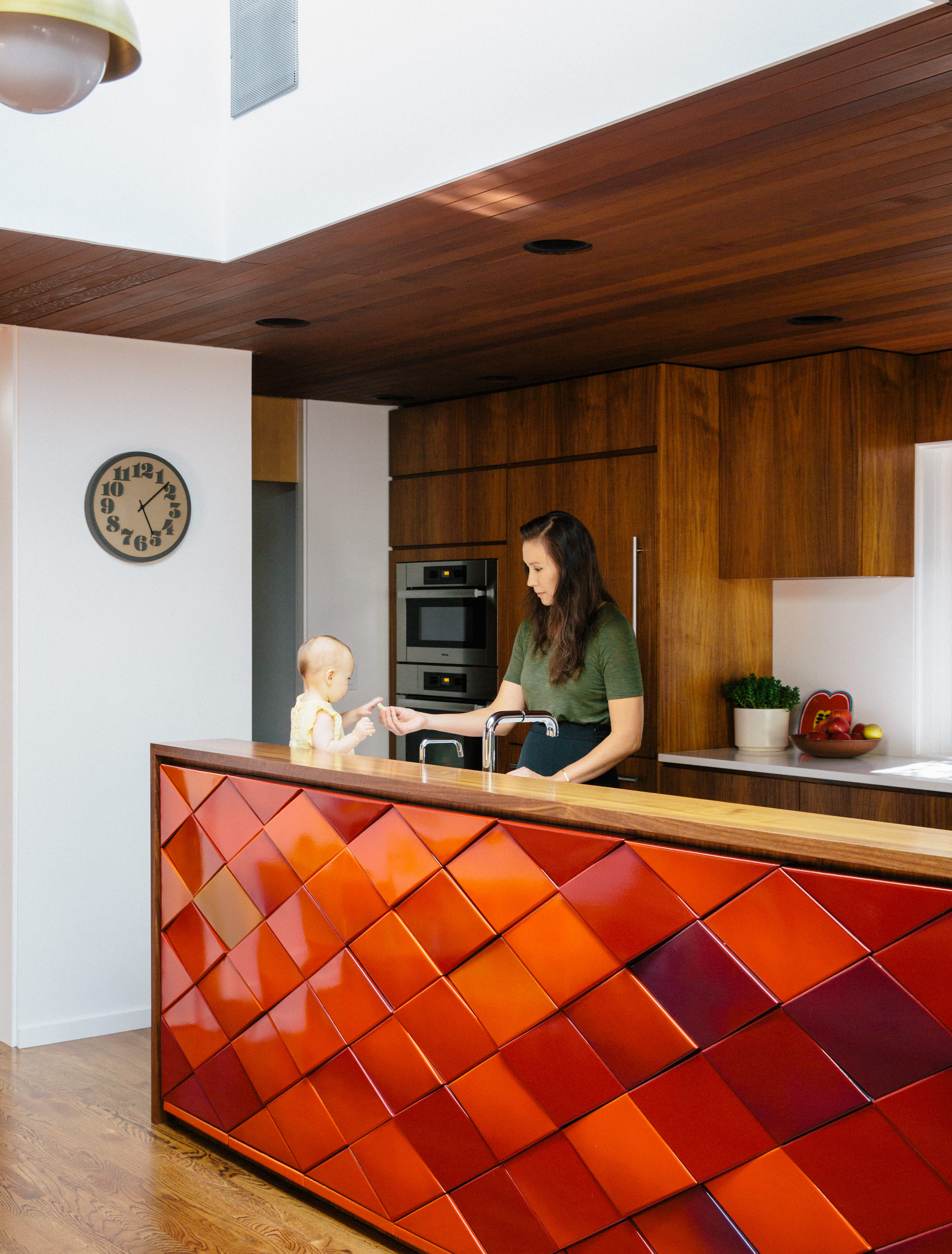 Red tiles brighten up the kitchen and provides views throughout the house.