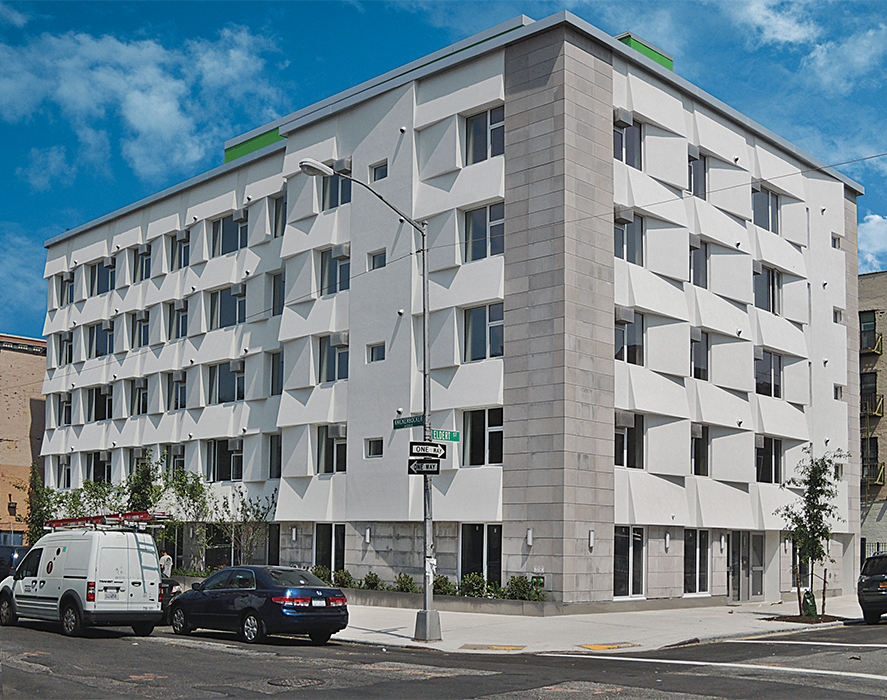 Modern affordable multifamily passive houses like the Knickerbocker Commons in Brooklyn by Chris Benedict with a foam and stucco facade