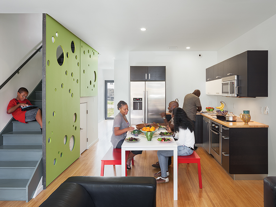 Modern affordable multifamily passive houses like the Belfield Avenue Townhomes in Philadelphia by Onion Flats wtih carbonized bamboo floors, fiberboard screen, bosch appliances, and induction cooktop