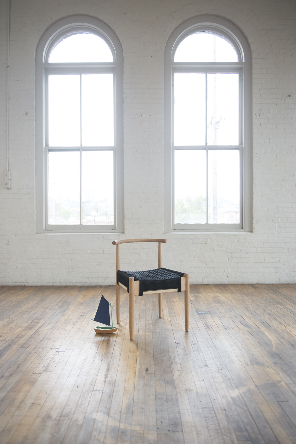 Habor Chair with a woven rope seat by Ben Klebba