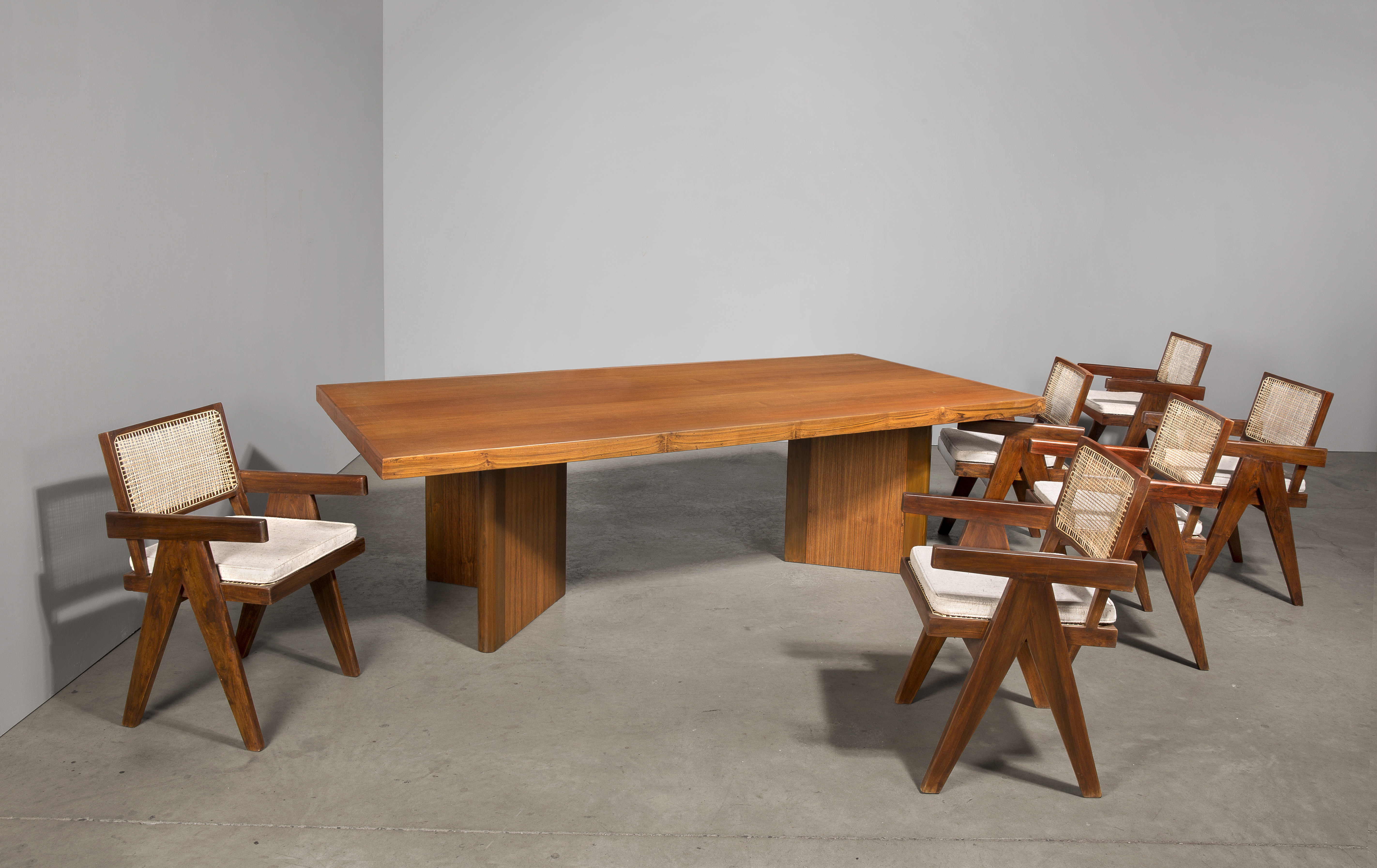 Table and chairs by Pierre Jeanneret